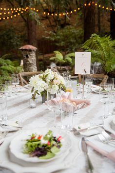 Grey, pink, and white really pop when your surroundings are lush greens! Elegant table setting for an elegant couple.