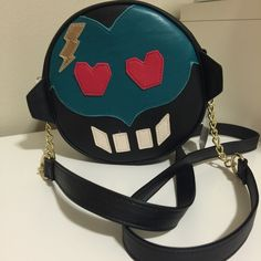 "🤖Betsey Johnson Monster Face Crossbody Bag🤖 How flippin' cute is this crossbody??!!...or maybe I should say scary 😱😉!...I thought this guy was a robot but I'm betting he is a monster..either way definitely a fun way to hold your on the go needs for work or play...crossbody strap with goldtone link chain..goldtone hardware and ""lip"" zipper pull....measures 7"" across. ❤️🤖😱❤️ Betsey Johnson Bags Crossbody Bags"