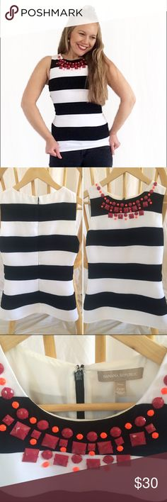 """Banana Republic Black and White Embellished Tank Black and white striped tank with pink/purple and orange embellishments at the neckline. Please note that the size is 00 PETITE. The shell is 100% cotton and has a poly liner. The fabric does not provide stretch. For reference, I'm 5'1"""" with approximately a 25"""" waist and this top is snug. Banana Republic Tops Tank Tops"""