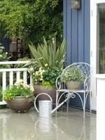 large planting pots by a garage - Google Search
