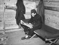 1940: A soldier reading inside his barracks at Fort Dix, New Jersey - Found via The Passion of Former Days