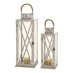 """Two-piece lantern set with warmly weathered finishes and rope-inspired handles.Product: Small and large lantern   Construction Material: Metal, rope and glass   Color: Silver   Features: Rustic rope handlesLattice details   Accommodates: (1) Candle each - not included Dimensions:  Small: 18"""" H x 7"""" W x 7"""" DLarge: 24"""" H x 9"""" W x 9"""" D    Cleaning and Care: Wipe with a dry cloth"""