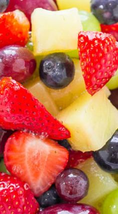 Pina Colada Fruit Salad ~ This EASY fruit salad is ready in 5 minutes tastes like a TROPICAL vacation... The fruit is tossed in pineapple juice and pina colada mix! Guaranteed party and potluck WINNER!!