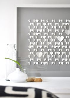 Cuadro con corazones de papel