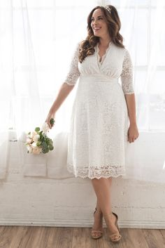 If you recently got engaged and are shopping for plus size affordable wedding dresses, our Wedding Belle Dress is a win. This gorgeous wedding dress is made with pretty scalloped lace and features a v-neckline, a line silhouette and 3/4 sleeves. Perfect for intimate ceremonies, courthouse weddings and elopements. Made exclusively for women's plus sizes. Made in the USA. Shop our entire collection of plus size wedding dresses at www.kiyonna.com.