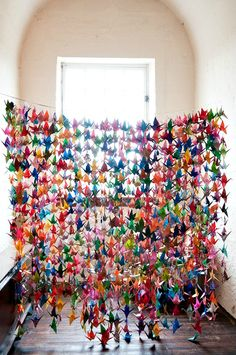 Paper Crane Curtain - lots o' cranes means lots o' color, whether they're backlit by the sun in a window or acting as a festive room divider or wall decoration. Id want all white and or an accent color