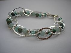 Want to make this, looks easy and is fancy! Sterling Silver Bracelet with Gemstones threaded through the loops