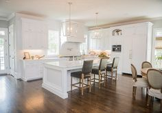 Classic white kitchen with brushed nickel lanterns and white marble countertops