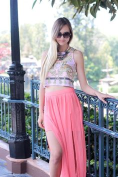 Cute spring/summer outfit.... The background looks like she's in Disneyland?