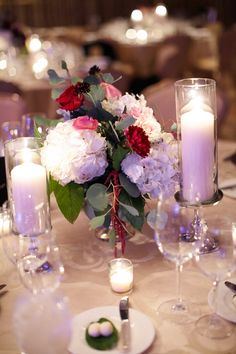Pillar candles and gorgeous bouquets  / Wrap It Up Parties / Chicago Wedding / Chicago Wedding Planner / Partial Wedding Planning / Day of Wedding Planner / Winter Wedding