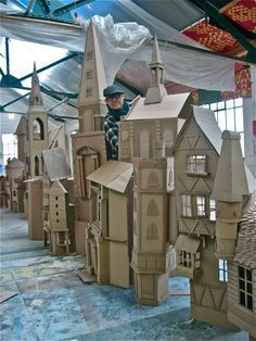 Simon Costin making houses from cardboard boxes for the Museum of London's 'Dickens and London' exhibition.