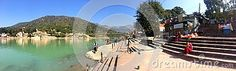 A panoramic image of the Ram Jhula baithing ghats with pilgrims and others sitting on steps in the foothills of the Himalayas in Rishikesh Uttarakhsnd India Panoramic Images, Rishikesh, Pilgrims, Boat, India, River, Dinghy, Goa India, Boats