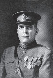 Captain George Mallon - Led nine men in attacking a battery of four howitzers, rushing the position and capturing the battery and its crew. He personally attacked 1 of the enemy with his fists. Later, when they came upon 2 more machineguns, he sent men to the flanks while he rushed forward in the face of the fire and silenced the guns.  His actions resulted in the capture of 100 prisoners, 11 machineguns, four howitzers and 1 antiaircraft gun. September 26, 1918