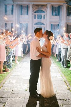 beautiful wedding photo idea - a kiss at the end of a sparkler send off