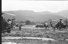 """hmm-364: """" This airstrip ran up the valley beside the Nam Dong base. The picture shows a number of HMM-364 choppers getting ready to take troops from that base out on an assault. The strip alternated between being a place a fixed wing aircraft could..."""