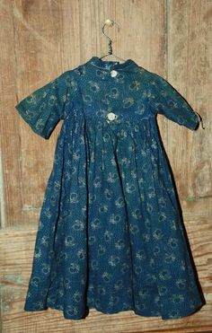 Early childs blue calico dress.
