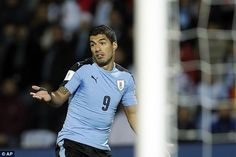 Uruguay striker Luis Suarez rues a missed opportunity during their loss to Argentina