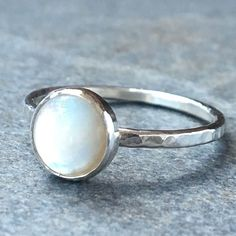 Peek inside Emma's Jewelry Box and you will find a sweet little mother of pearl stack ring. A perfect silhouette on its own or stacked with your favorite silver rings, add a bit of whimsy to any style