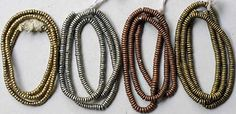 http://www.picardbeads.com  #C-34 Ethiopian and Kenyan heishi  From left: Ethiopian brass, 3mm bead size; $3.00/strand  Nickel, copper and Kenyan brass are 4mm diameter.  Price is $4.00 strand  All strands are 16 - 17 inches long