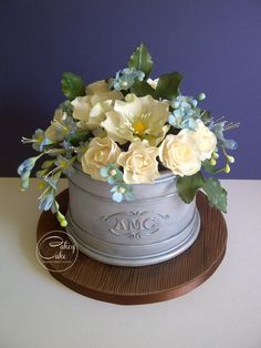 Galvanised Planter I wanted this vanilla cake to look like a galvanised, monogrammed planter, so painted it with edible silver,. Beautiful Cakes, Amazing Cakes, Fondant Cakes, Cupcake Cakes, Flower Pot Cake, Flower Cakes, Fab Cakes, Bottle Cake, Garden Cakes
