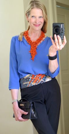 Parures de Samourais scarf worn as a belt. Hermes Kelly Pochette in black croc and black croc Kelly Dog bracelet. Necklace by MaiTai Collection. Top by Gerard Darel.
