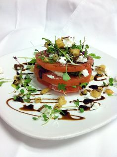 Kamuela Tomato & Goat Cheese Stack with a sweet basil pesto & balsamic reduction