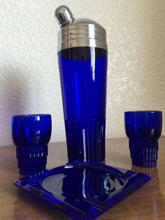 The Cocktail Shaker was made by Paden City Glass and is their # 215 Glades line. You can find this shaker in Ruby color fairly easy, but is very hard to find in Cobalt. The Tumblers and the ashtray were made by Duncan Miller Glass Company and is called Terrace. They were all made about the same time 1930's into the 1940's.