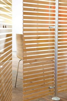 3form - Timber slatted-look panels  Timber slatted-look panels in translucent Varia Ecoresin with alder-wood interlayers by 3form