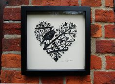 This is the original paper artwork of my design 'Robin in Berried Hawthorn Bush'. All of my paper cuts are cut by hand using a scalpel. It is mounted on an ivory-coloured mountboard, a few millimeters above the backing so that you can see a shadow of . Hawthorn Bush, Valentine Heart, Valentines, Paper Artwork, Three Dimensional, Shadow Box, Paper Cutting, Robin, My Design