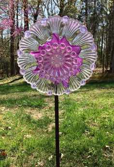 This one of a kind glass creation features an azure blue & orange handpainted shell edged pressed glass dish with handles and orange tea light holder as the center. The glass is adhered with silicon glue that is waterproof and sun/freeze proof. Glass Garden Flowers, Glass Plate Flowers, Flower Plates, Hummingbird Garden, Stained Glass Crafts, Purple Glass, Garden Statues, Yard Art, Flower Art