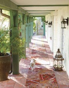 distressed wood, distress walls, terracotta floors, clay pots by guida