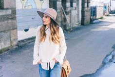 Jess Kirby wears an Ann Taylor Ruffle Sleeve Sweater and Silk Button Down Blouse with Long Wavy Hair
