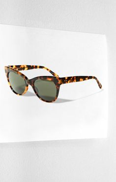 Norma Kamali's cat-eye sunglasses are perfect way to get into the Mad Men mood.