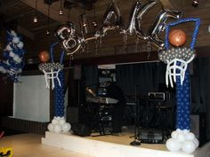 Basketball Hoop balloon sculpture. Basket ball themed balloon column and name. www.dreamarkevents.com