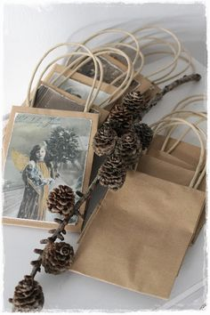Could upcycle old/used Christmas cards to make gift bags :)