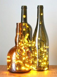 How to Put Christmas Lights in a Wine Bottle. Turn any glass bottle into a glowing focal point with little more than a string of LED Christmas lights and a diamond hole saw drill bit. Christmas Wine Bottles, Lighted Wine Bottles, Bottle Lights, Bottles And Jars, Decorating With Wine Bottles, Crafts With Glass Bottles, Wine Bottle Lighting, Cut Wine Bottles, Wine Bottle Lanterns