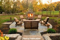 Small patio area with a tile walkway, a small brick fireplace and plenty of outdoor furniture. Did you know an outdoor fireplace can be as cheap as $1,400?