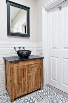 White tiled wall, mosaic tiled floor & stunning teak cabinet with Bluestone marble sink