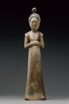 Standing female attendant, Tang dynasty (618–906), late 7th–early 8th century  China  Wood with pigment