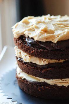 The perfect chocolate cake recipe with a hint of pumpkin, chocolate ganache and the best caramel buttercream ever! www.lemonsforlulu.com