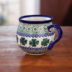 I love the rounded shape and colors of this St. Patrick's Day mug! ---------- St. Patty's Polish Pottery Mug, Irish Daisies