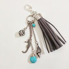 Grey and silver nautical sea themed planner charm works will most all ring type planners, it will also fit in zipper pulls for jackets, bags, and more. This handmade planner charm measures about 4 inc