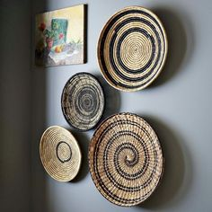 handwoven with concentric circles, spirals or ikat circles made of rapidly renewable seagrass. Hanging hooks on the back make installation effortless