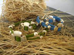 Pulseras y anillos de cuero varios colores con piezas zamak flor de cuatro petalos