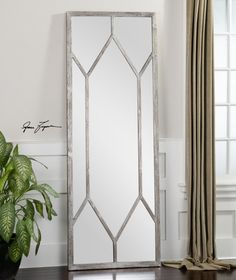 Uttermost - 13844 This oversized mirror features a distressed, silver leaf frame with noticeable wood grains. May be hung horizontal or vertical. Designer: Grace Feyock Dimensions: 29 W X 79 H X 2 D (in)