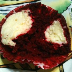 Yum red velvet cupcakes with a cheesecake center - so easy to do!  Make your regular cake mix and in a separate bowl mix 1 8oz block of softened cream cheese, 1/3 cup granulated sugar, 1 tsp vanilla extract and 1 egg.  Fill your muffin cups with cake batter then scoop a spoonful of cheesecake mix onto the cake batter and bake as directed.