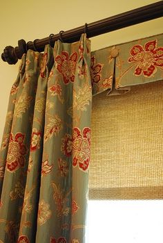 Love the little valance on top of the woven woods. It adds great layering to this treatment.