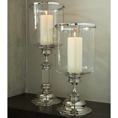 This lovely candle hurricane features a nickel base with a glass top. The Small…