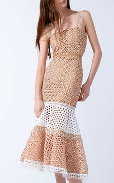 This **Alexis** dress is rendered in variegated lace and features a square neck with scalloped shoulder straps, a fit-and-flare silhouette with a midi length hem, and a colorblock design at the skirt.