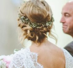Pinterest Wedding Hairstyle We Love: A Twisted Low Bun with a Flower Crown - Weddings Magazine